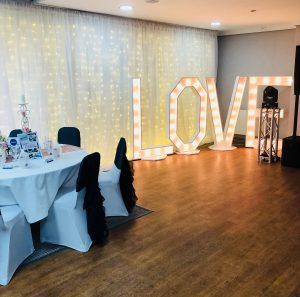 function room with love sign